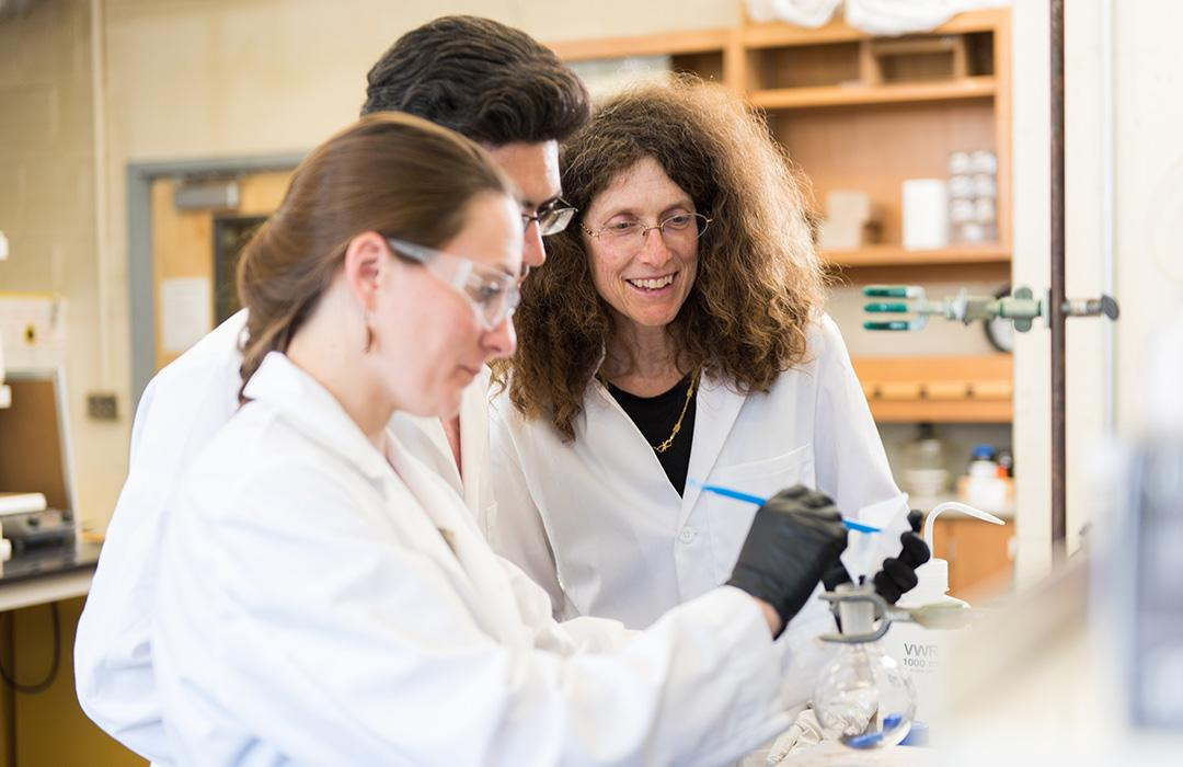 May Nyman with students working in lab
