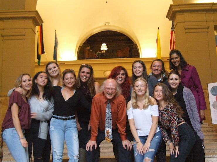 group photo of Kevin Ahern with female students in Memorial Union entryway