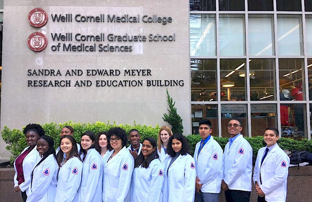Bella Karabinas at Cornell with colleagues in lab coats