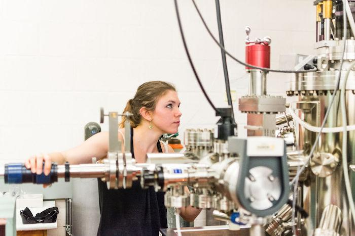 Bethany Matthews working with lab equipment