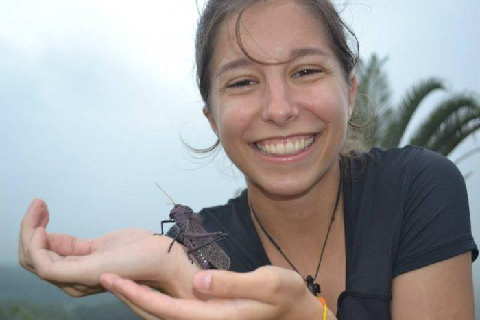 Lindsey Ferguson holding insect during study abroad