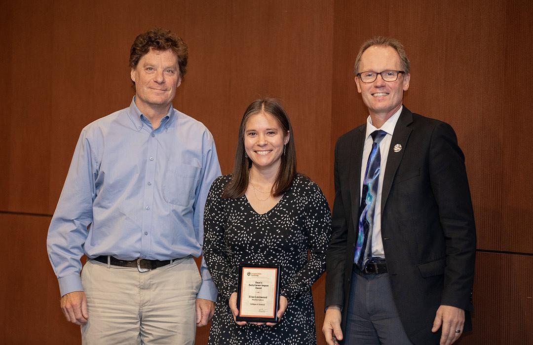 Elise Lockwood receiving award from Bill Bogley and Roy Haggerty