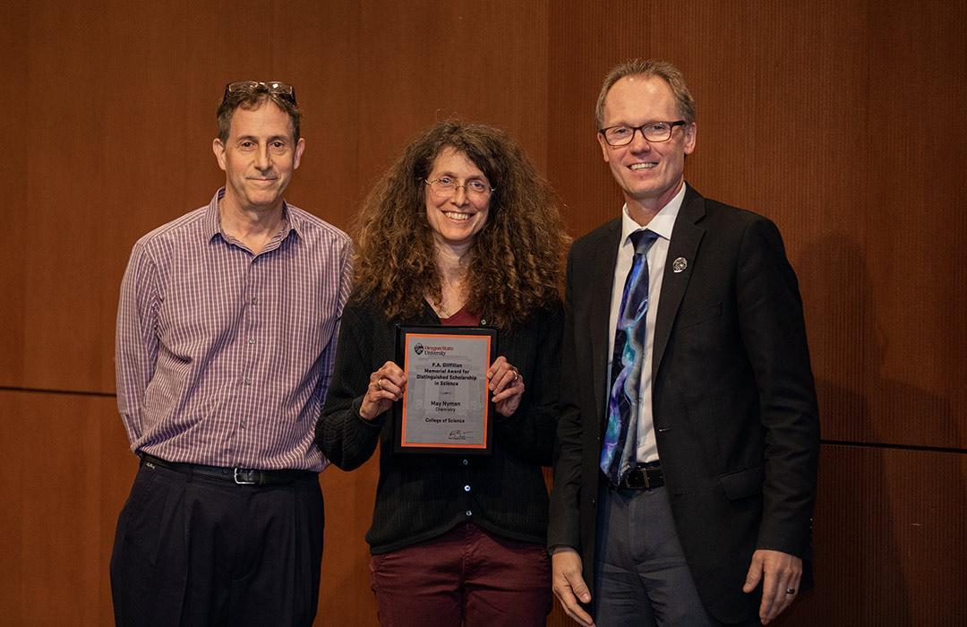 May Nyman receiving award from Michael Lerner and Roy Haggerty