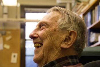 Ken Hedberg smiling in his office space
