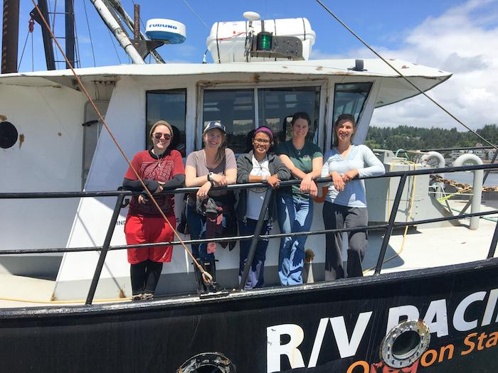 Sarah Henkel, Abigail Losli, and team on their boat