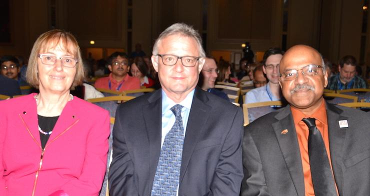 Jessica Utts, Joe Palca, and Sastry Pantula sitting in audience of JSM presentation