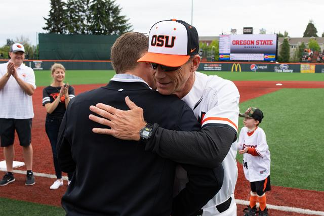 Morgan Pearson hugging baseball coach Pat Casey on Goss Stadium field.