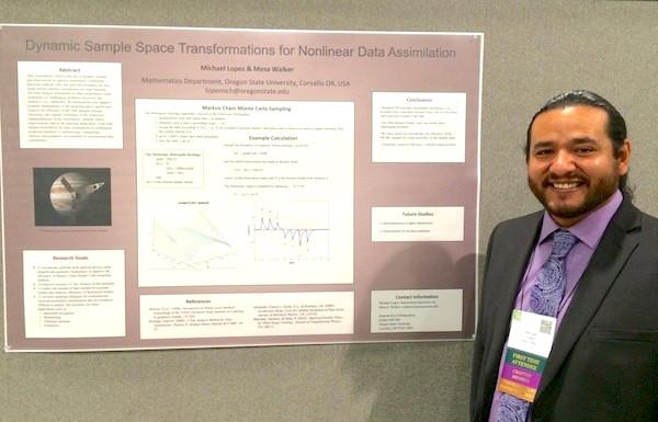 Micheal Lopez next to research poster