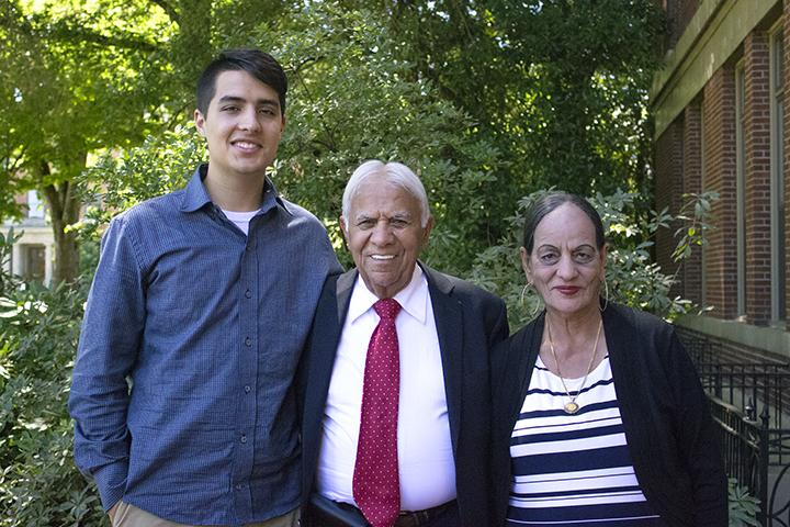 Satnam Sethi with grandson and wife standing in front of Kidder Hall