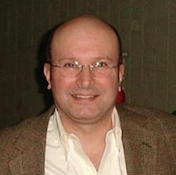 Alvaro Estevez in front of brown backdrop