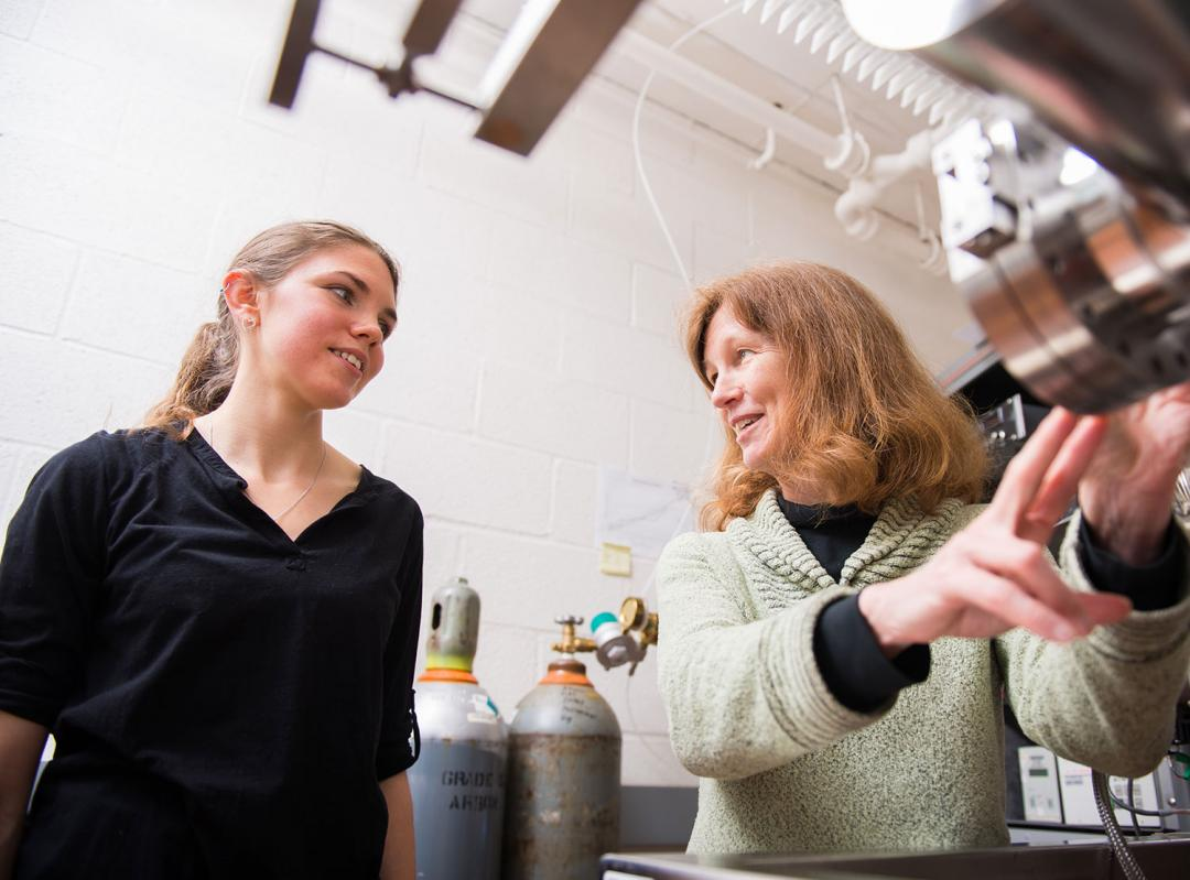 Janet Tate and Bethany Matthews working with equipment in lab