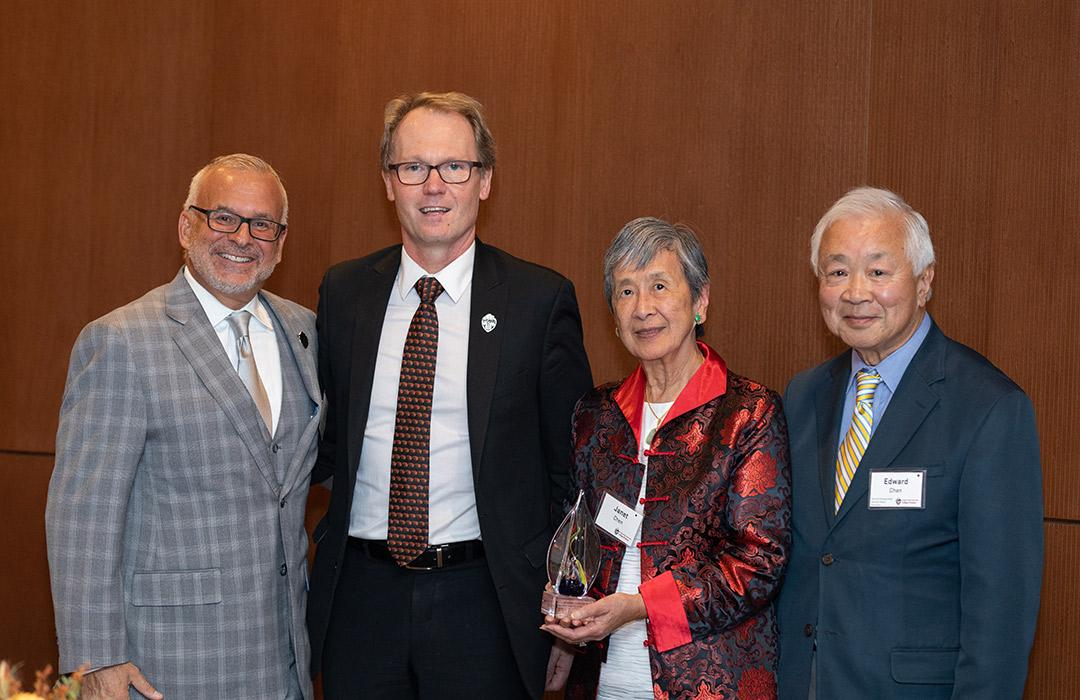 John Donnelly and Roy Haggerty giving award to Edward and Janet Chen
