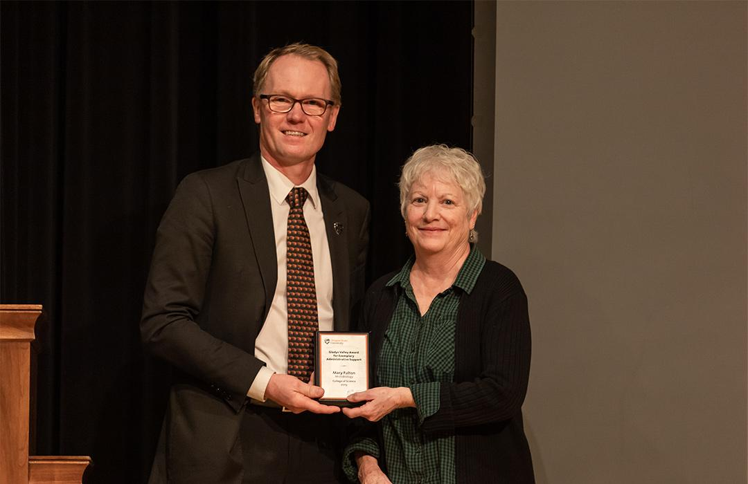 Mary Fulton receiving award from Roy Haggerty on stage