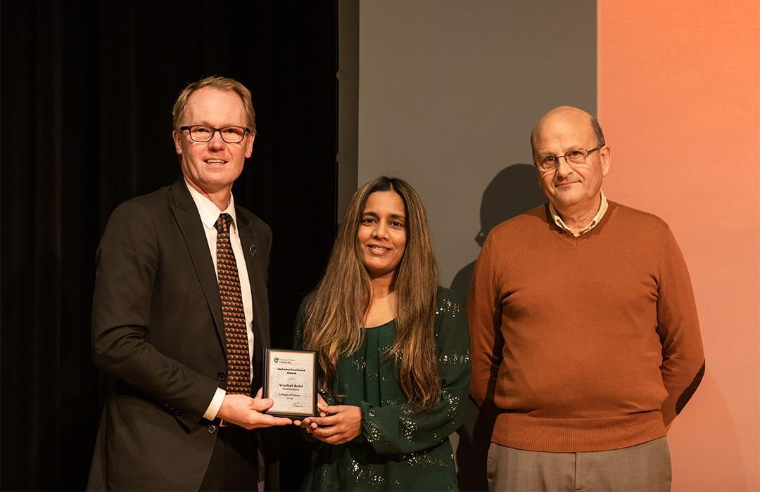 Vrushali Bokil receiving award from colleagues on stage