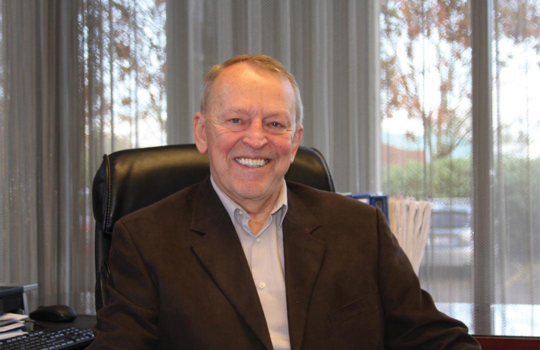Ron Schoenheit sitting in office space