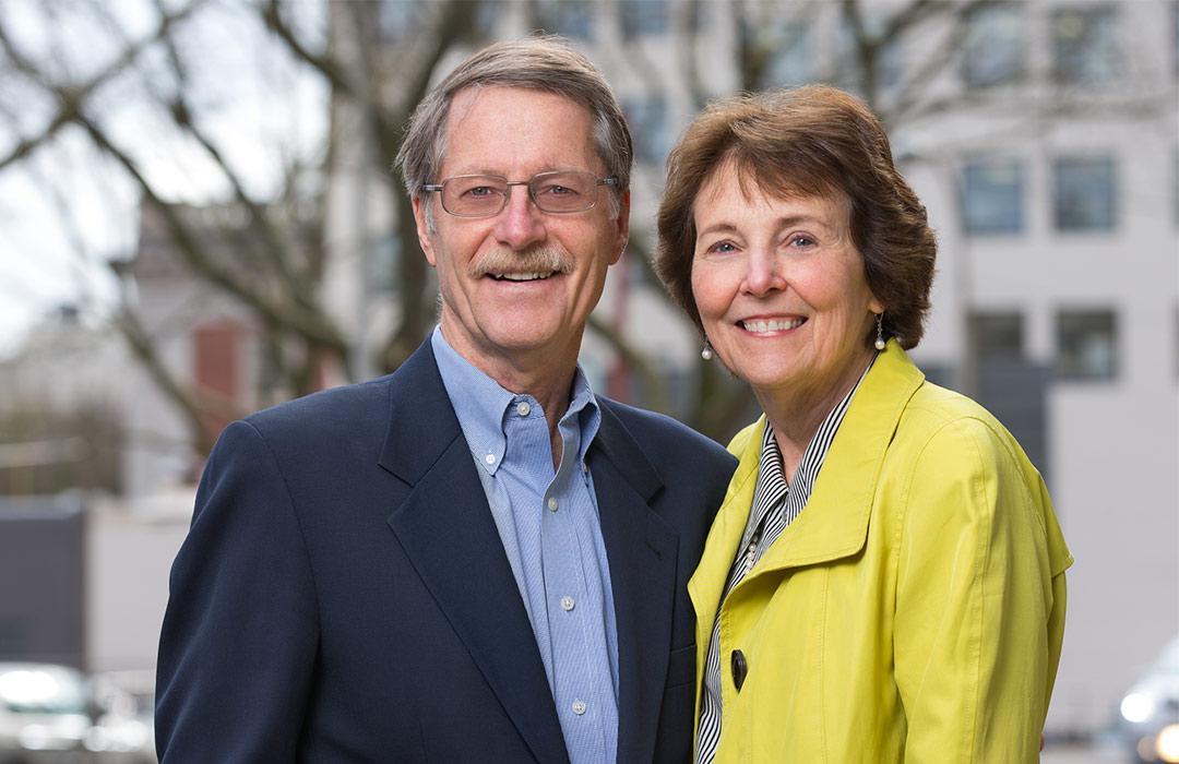 David and Christine Vernier standing outside