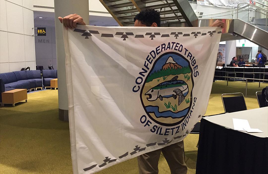 Zoology senior with Tribal flag