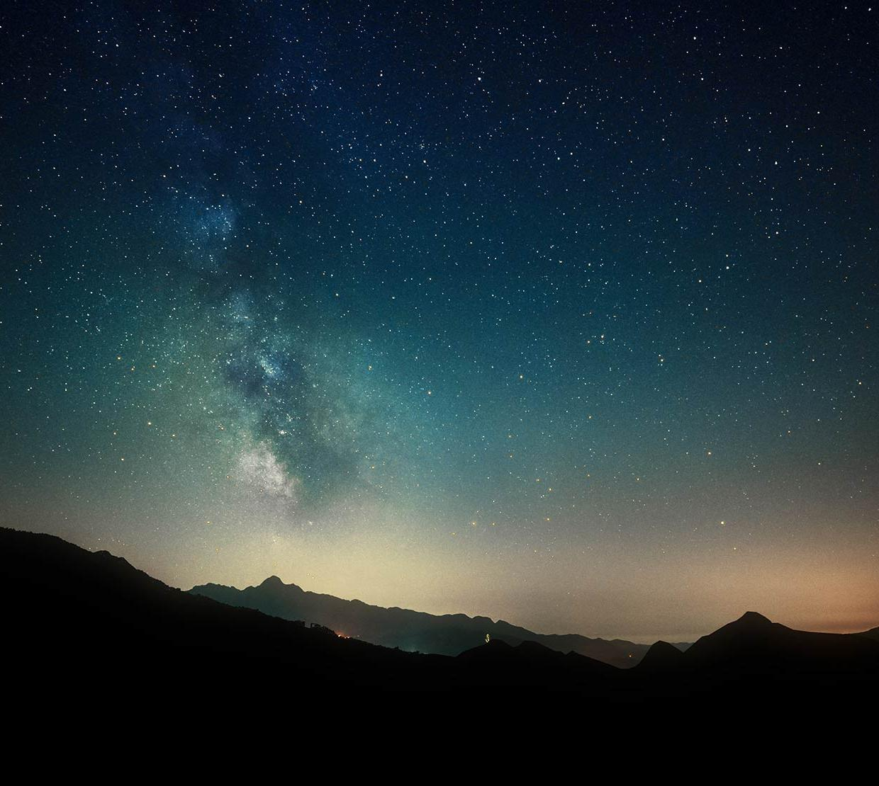 Starry time-lapse over mountain range