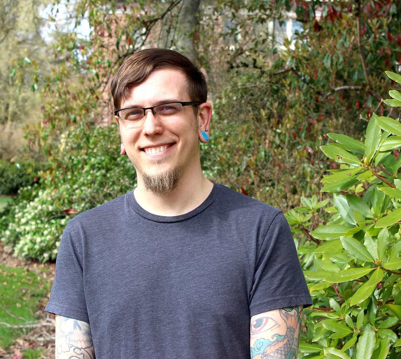 David Lynn Hubert in front of shrubbery