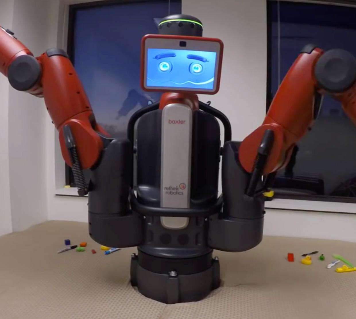 Robot with long arms sitting on office table