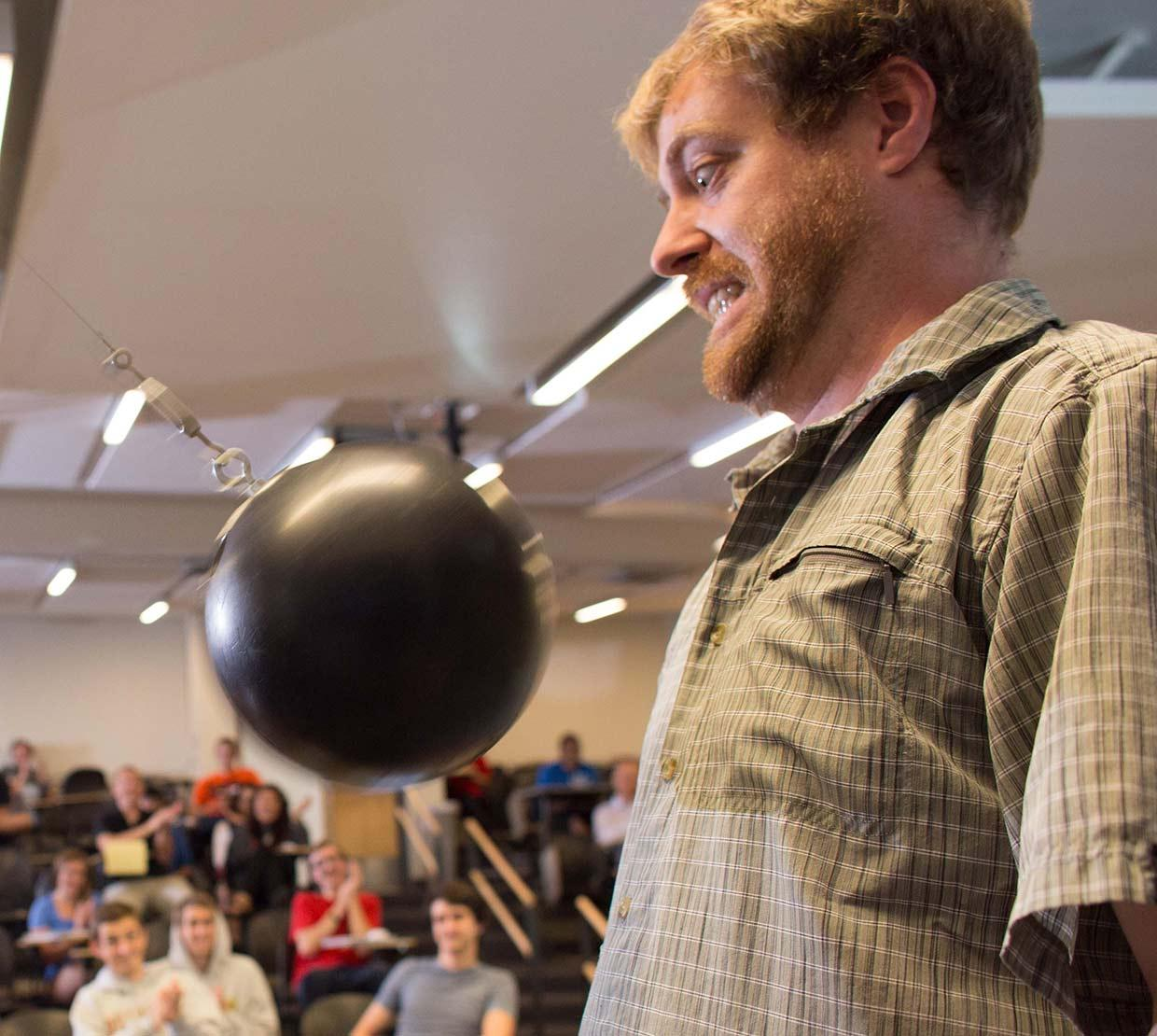 KC Walsh giving using bowling ball in lecture demo
