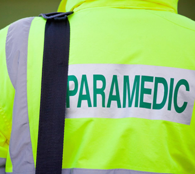 back of neon green paramedic coat