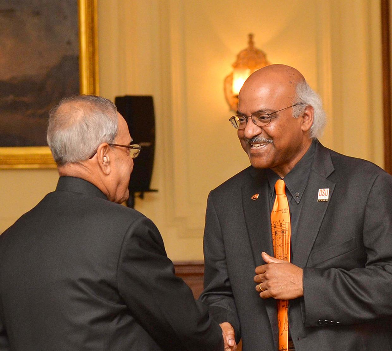 Sastry Pantula shaking hands with Mukherjee president