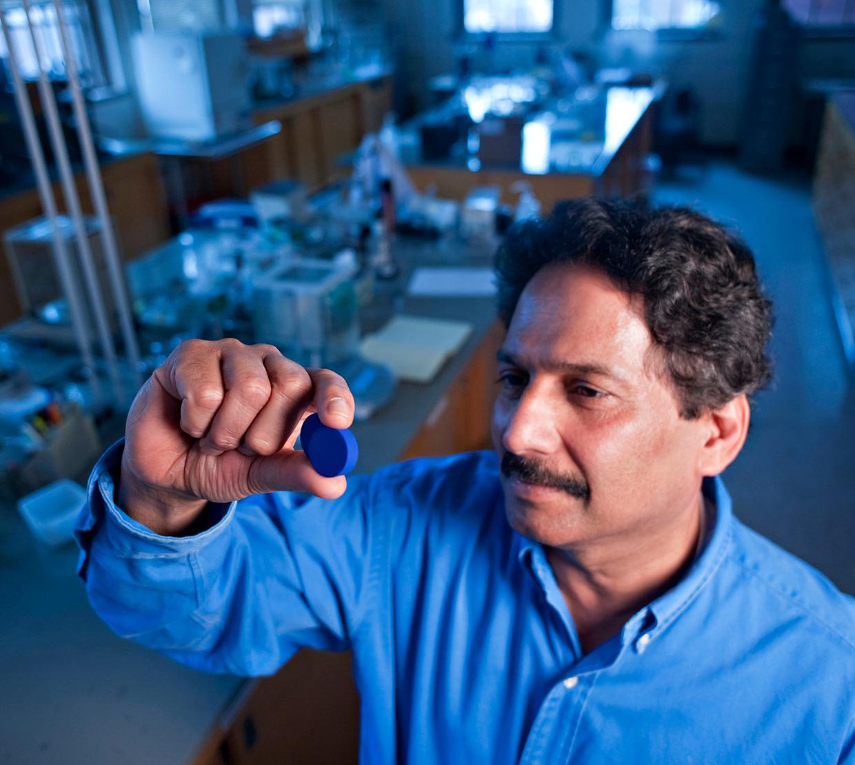 Dr. Mas Subramanian analyzing blue pigment in chemistry lab