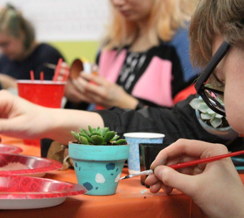 children painting succulent pots
