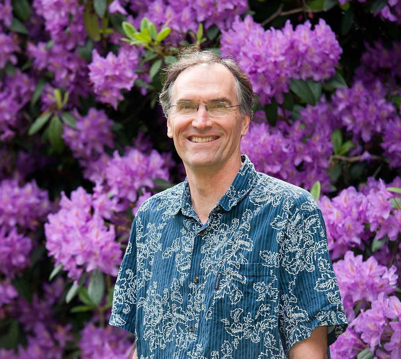 David McIntyre in front of purple bush