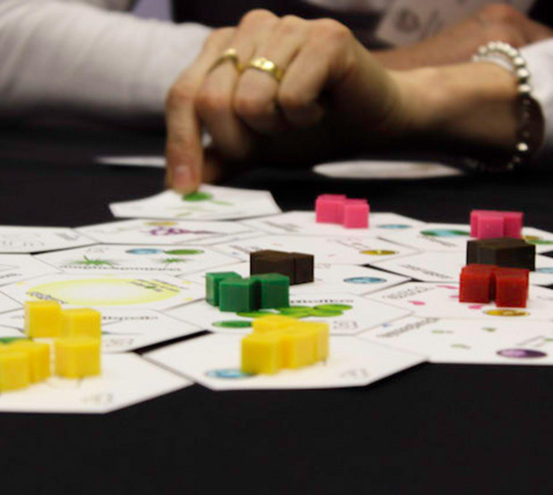 Female hand grabbing card in board game