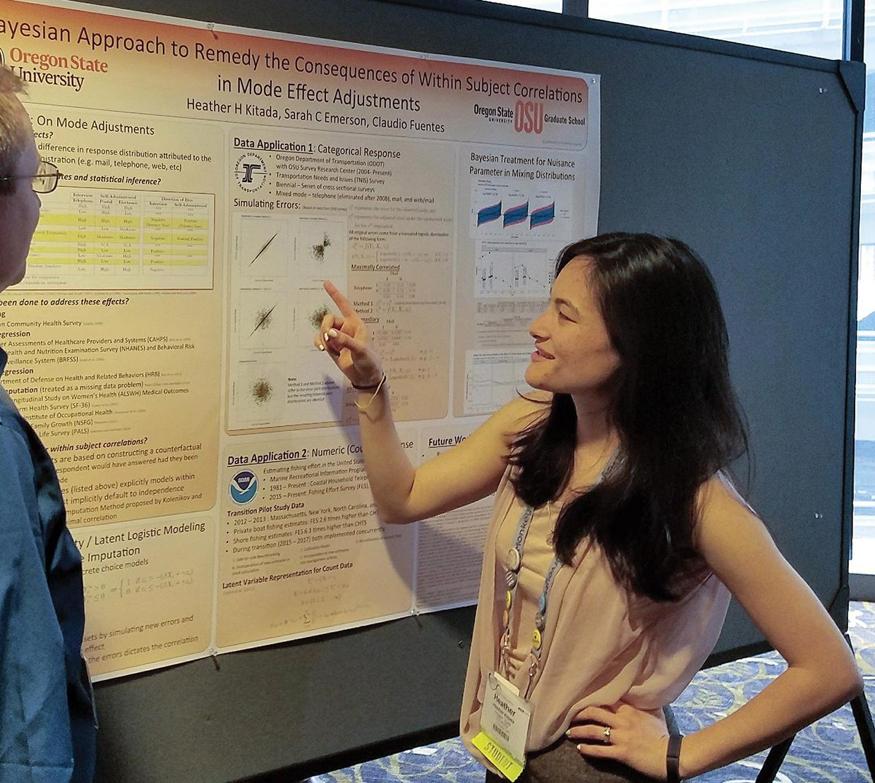 Heather H. Kitada talking about her research poster