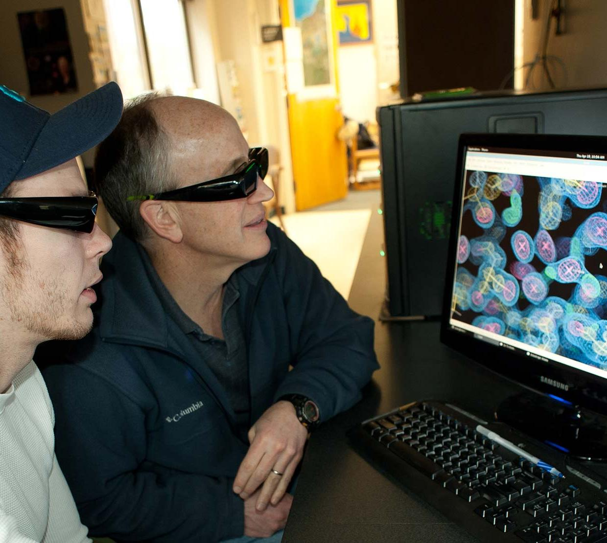 Andy Karplus and student analzying X-ray crystallography experiments