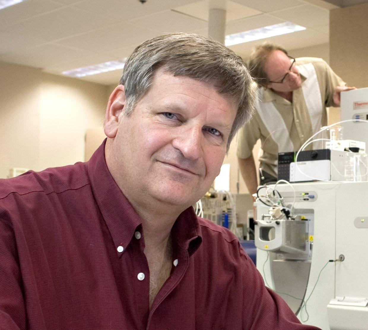 Joe Beckman in his lab with colleagues