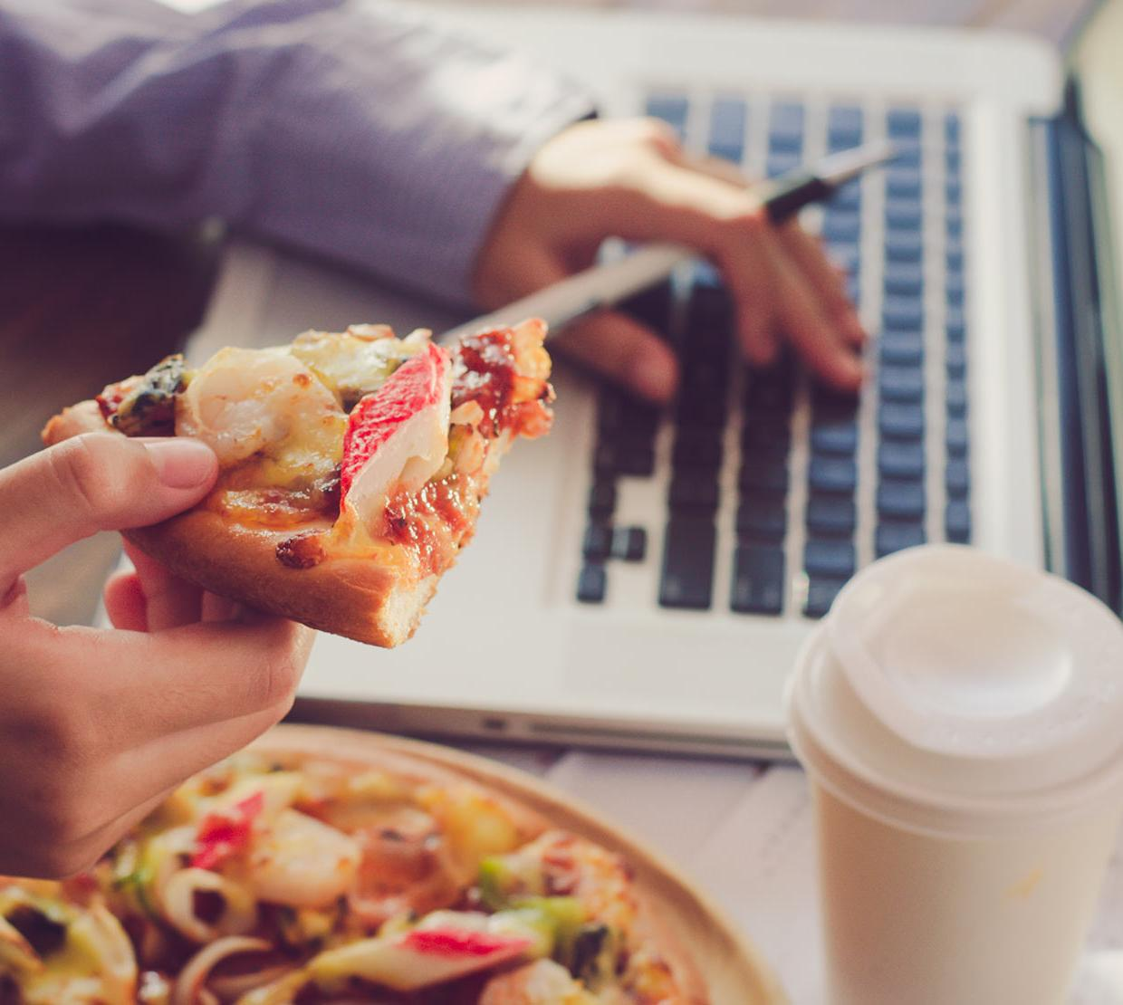 Working on homework with pizza and coffee