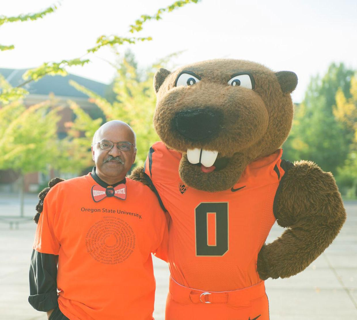 Dean Pantula with Benny the Beaver outide Reser