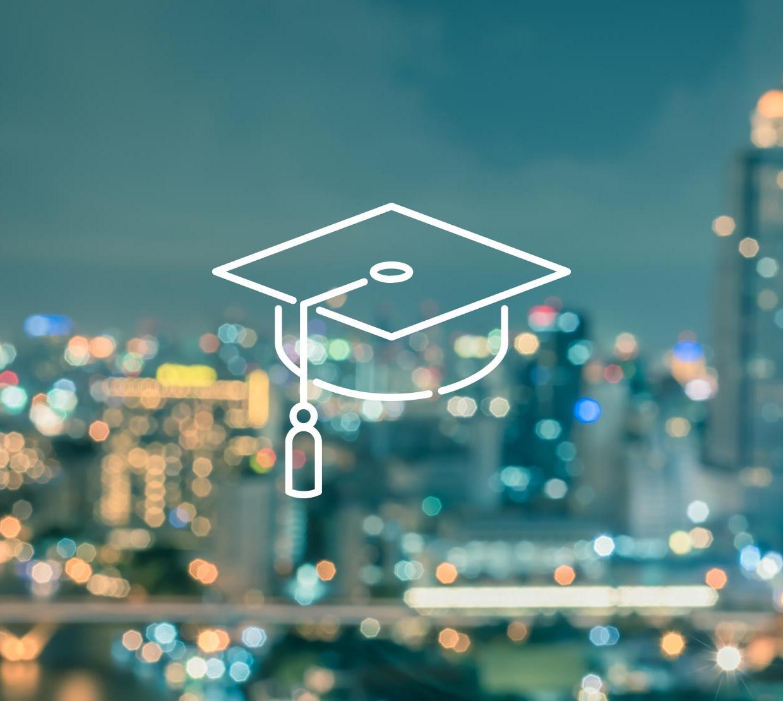 Graduation cap icon above cityscape texture