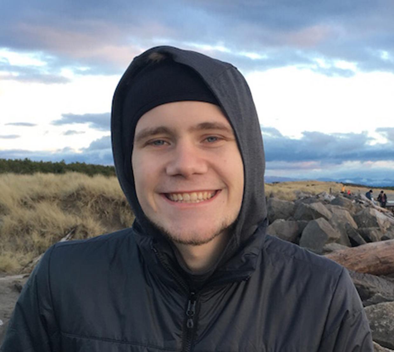 Jason Sandwisch standing in Oregon coastal field