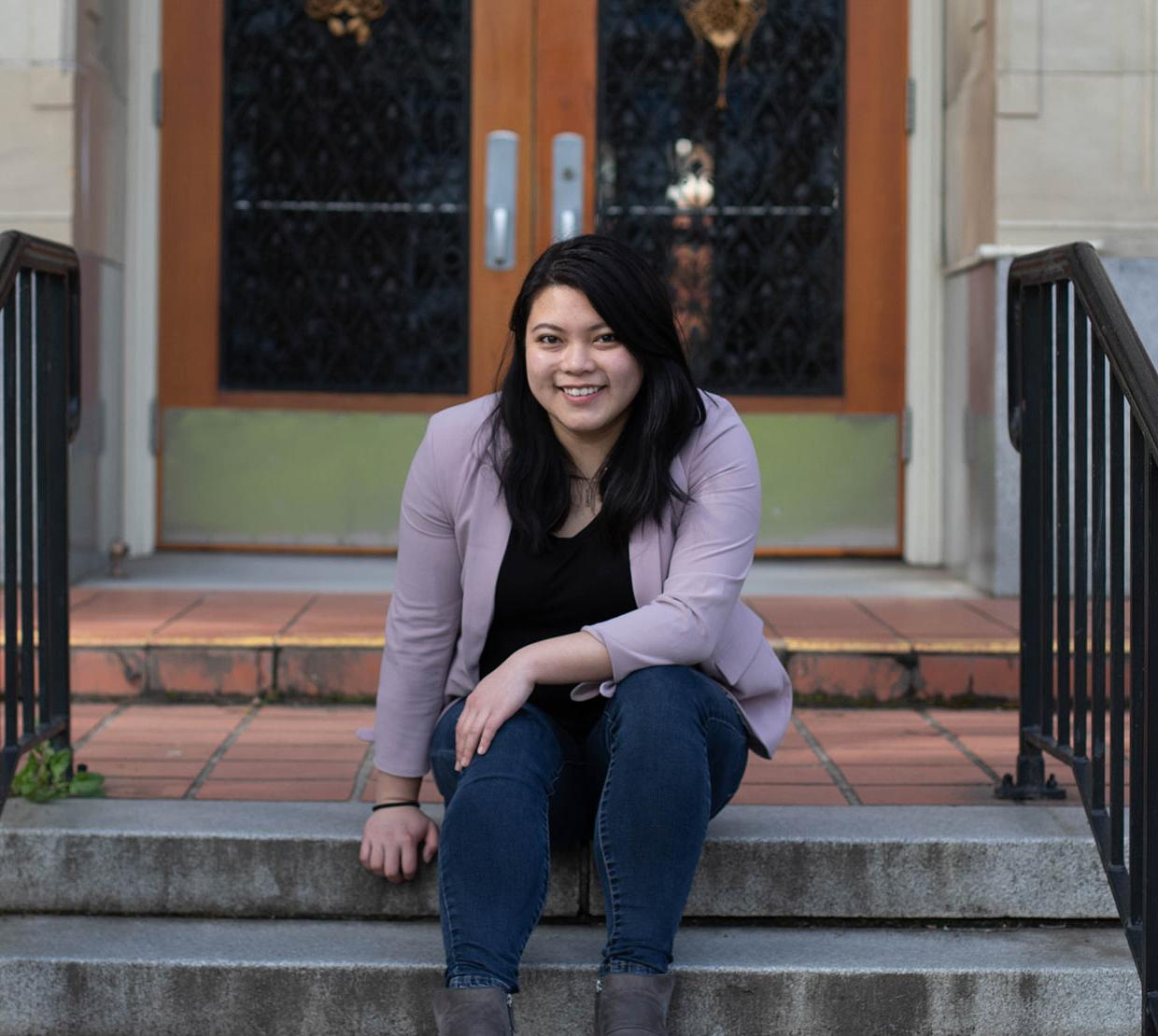 Sydney Phu in front of Kidder Hall