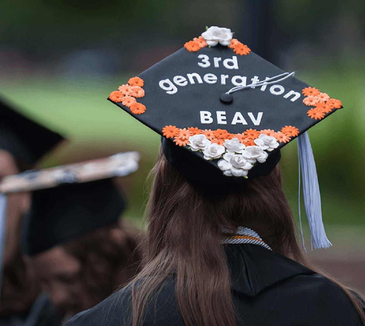 """decorated graduation cap with """"3rd Generation Beav"""" collaged on"""