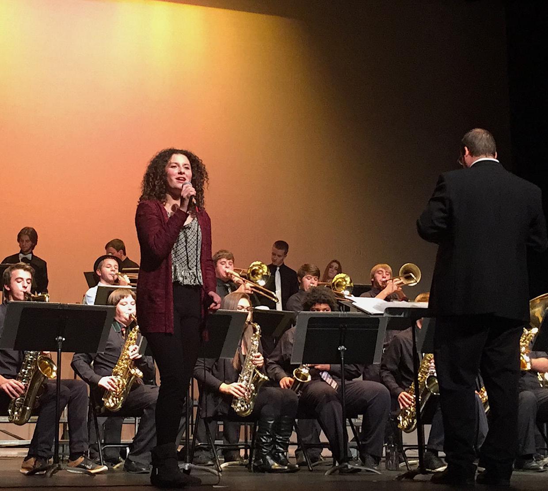Bella Karabinas singing with jazz band on stage