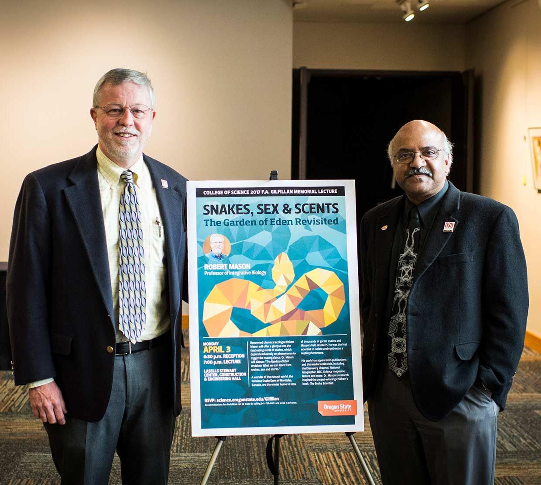 Robert Mason and Sastry Pantula standing next to event poster