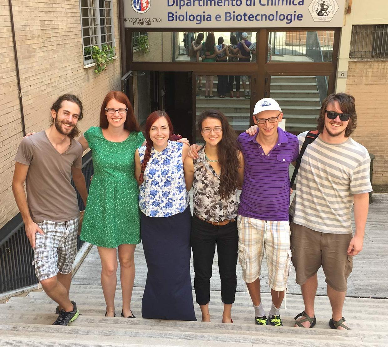 Arianna Kahler with friends standing on stairs in Italy