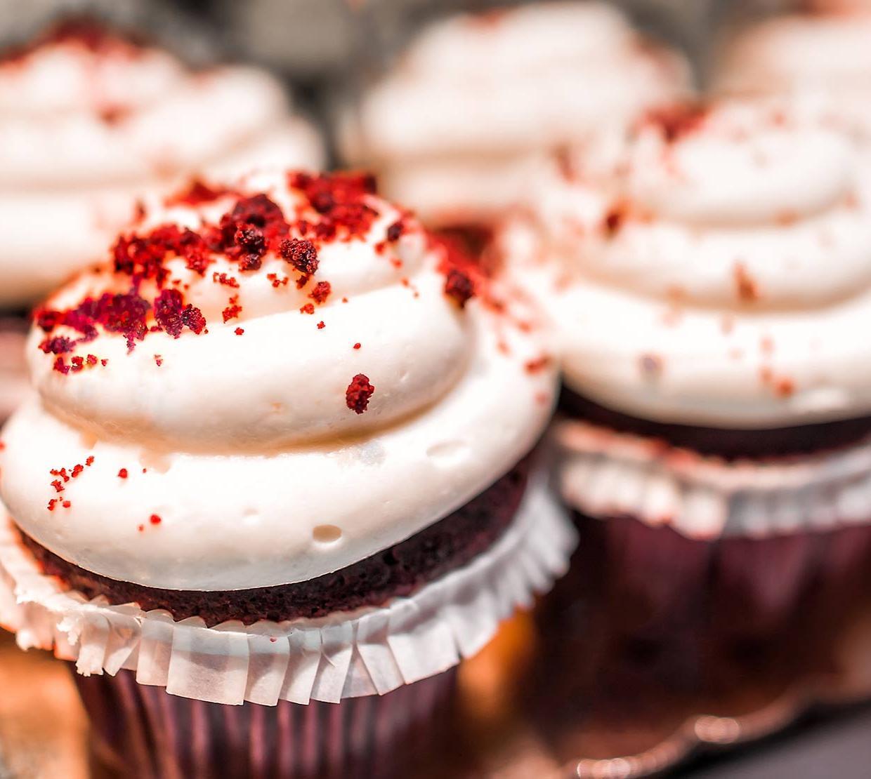 red velvet cupcakes sitting on tray