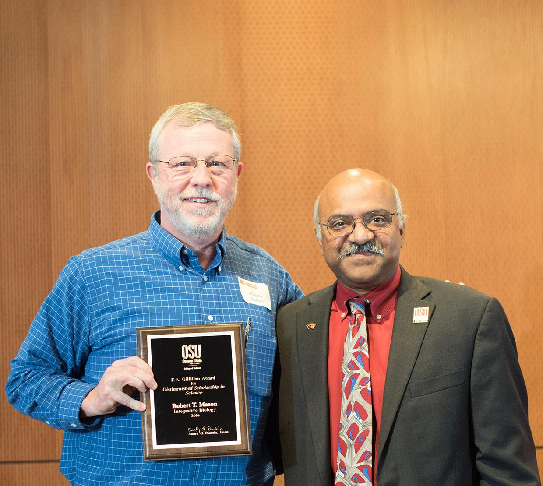 Robert T. Mason receiving award from Sastry Pantula