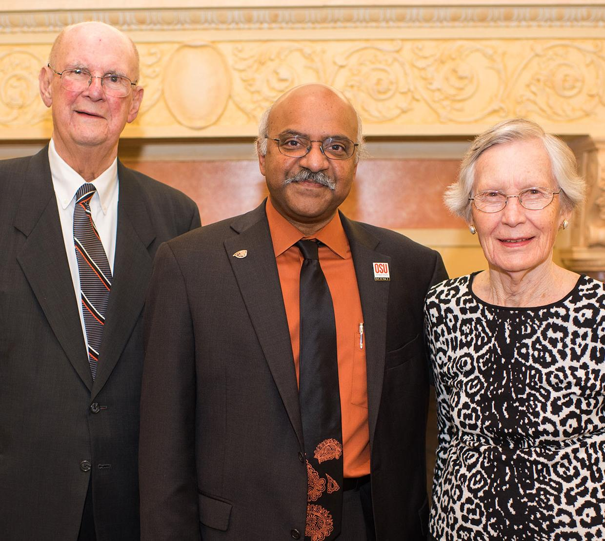 Ben and Elaine Whiteley with Sastry Pantula in front of decorative fireplace