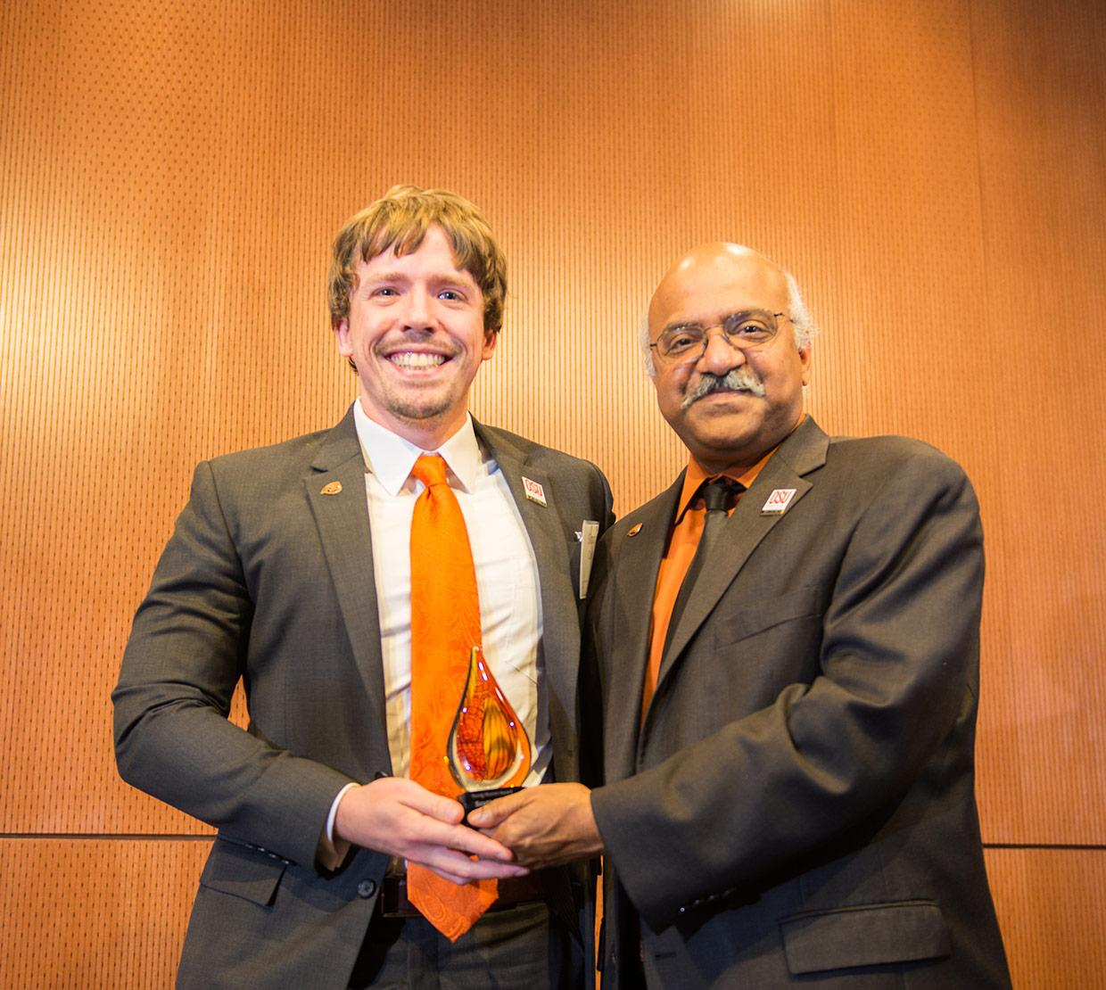 Sastry Pantula giving Scott Clark his alumni award