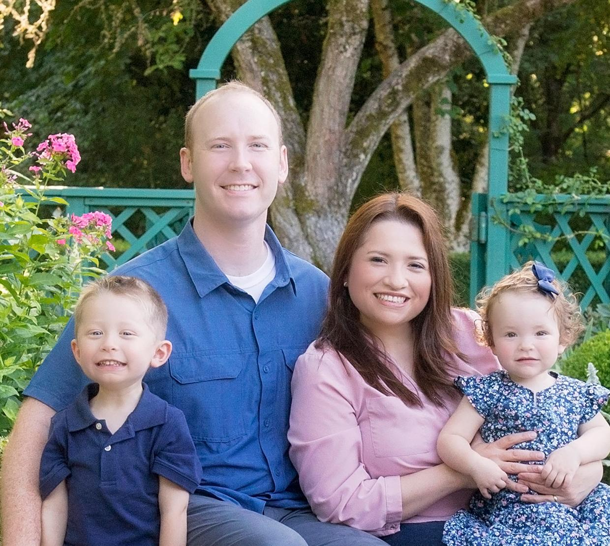 Drs. Luisa and Nathan Snyder with their children in garden