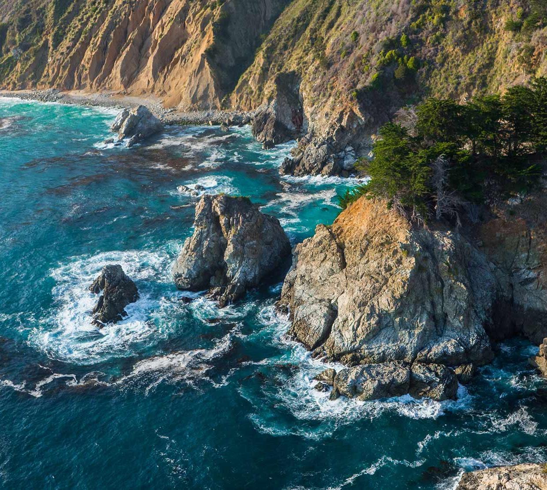 cliff side meeting ocean waves