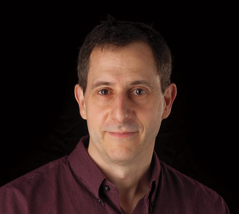 Michael Lerner in front of black backdrop